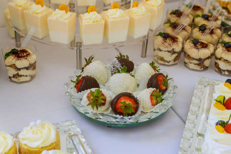 Table with sweets, dessert for a party in restaurant. Catering food.