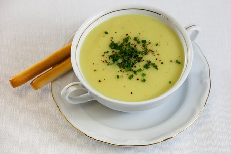 soup in cup with black pepper and chivas photo