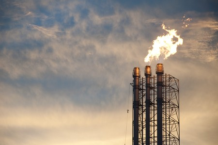 Flare stack from factory plant photo