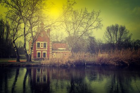 lake house: Vintage photo of haunted cottage in the forest