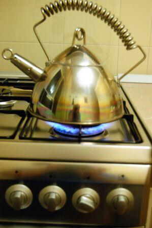 gas stove: Hot tea on a gas stove Stock Photo