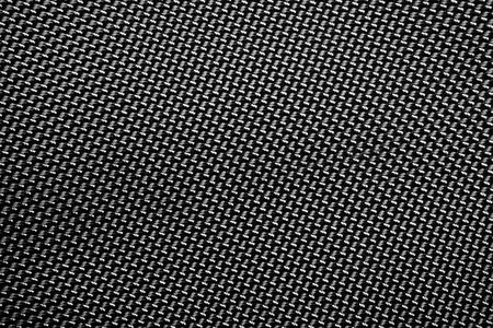 A tightly woven carbon fiber background close up Stock Photo