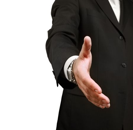 expertise concept: A business man shaking hands to seal a deal. Shallow depth of field, focus on finger-tips.