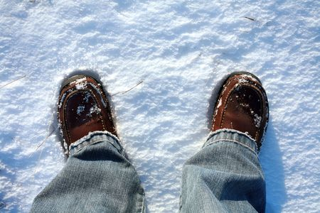 Foots in deep snow on north field photo