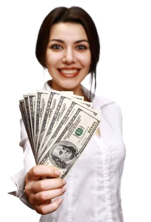 Woman holding out money. Focus on face (money out of focus). photo