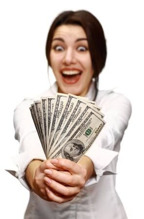 Woman holding out money. Focus on money (womans face out of focus). photo