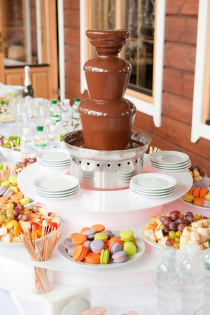 Dessert table whith chocolate machine fountain