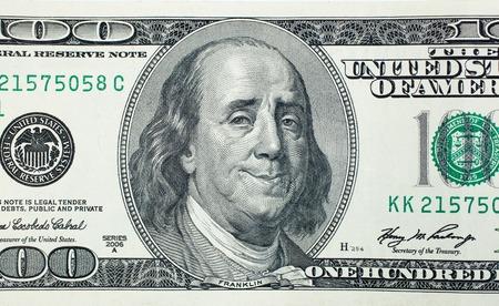 Happy President Benjamin Franklin on 100 US dollar bill 免版税图像