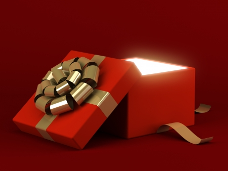 open present: Gift box open with gold ribbon bow and light background