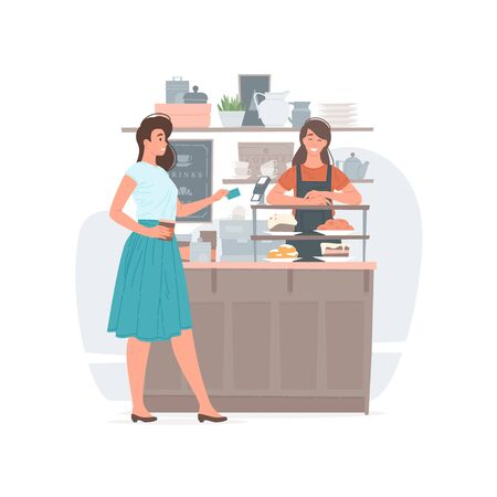 Woman paying for beverage in coffee shop
