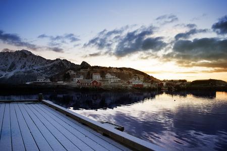 Sunrise on a wooden pier. Lofoten Islands, Norway, Europa