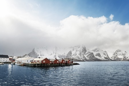 Rorbu winter against a snowy background rocks, Lofoten, Norway, Europa