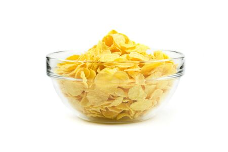 Cornflakes in a glass bowl. Isolated on white