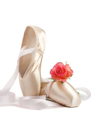 Ballet shoes with red rose on white background Stock Photo