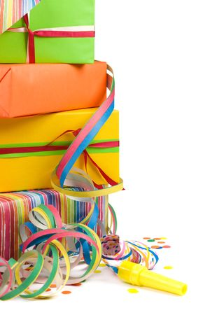 Stack of colored gift boxes with confetti and streamers Stock Photo - 2948787