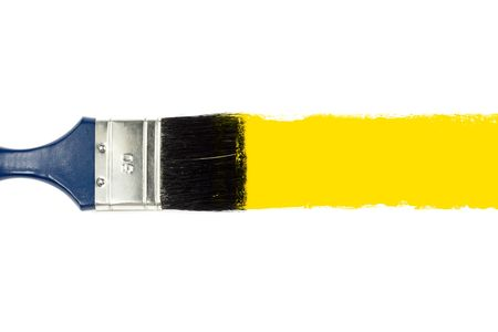 Brush and yellow paint stroke