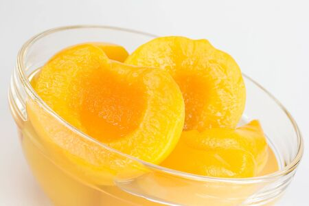 Peach halves in light syrup Stock Photo