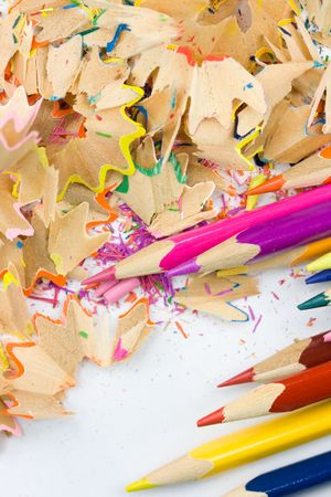 Colorful pencils and wood shavings photo