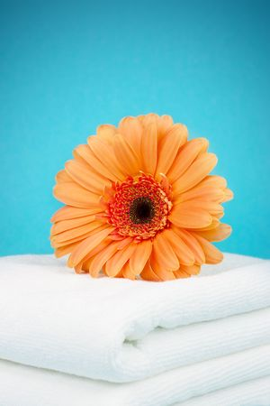 Orange flower on a white towels