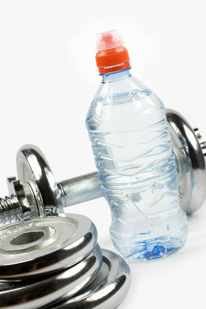 Metal dumbbell with bottle of water and weights Stock Photo - 3411910