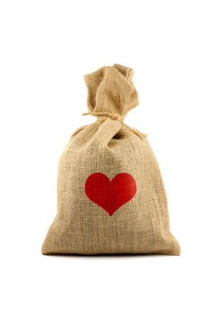 Brown sack with red heart. Isolated on white photo