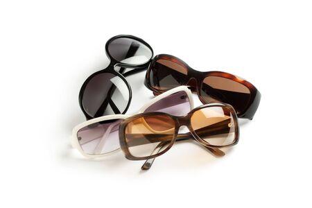 four stylish sunglasses isolated on white