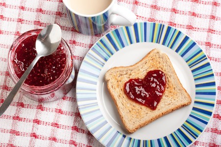 toast and jar with raspberry jam