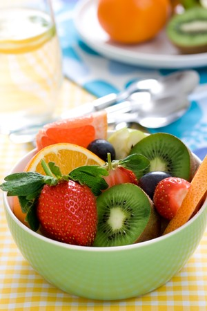 fruity salad with ripe fruits. shallow dof