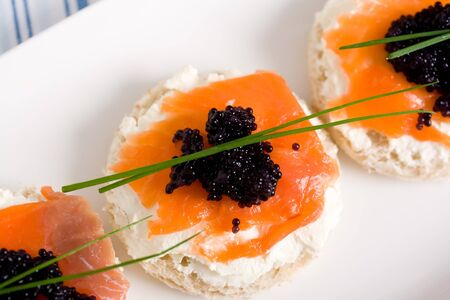 fresh salmon mini sandwich with black caviar Stock Photo