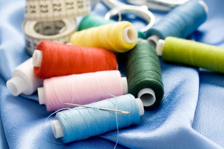 crafty: needle, threads and measuring tape. shallow dof