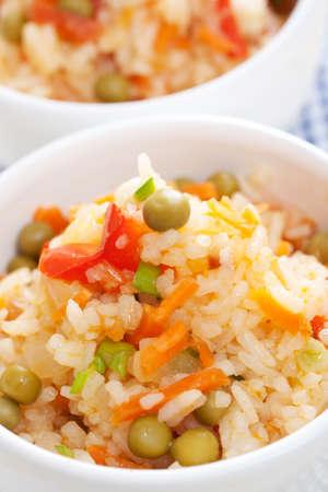 rice with vegetables in white bowl