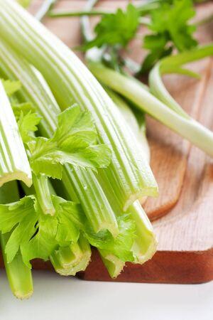 green celery on chopping board