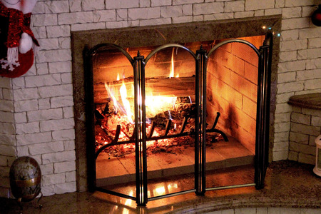 devouring: Blazing fire in a home fireplace on Christmas night