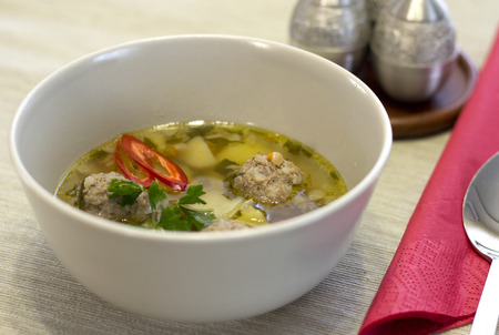 cooked pepper ball: soup with meatballs in a deep plate Stock Photo