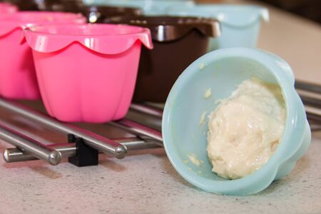 tins: Colorful muffin tins with homemade dough