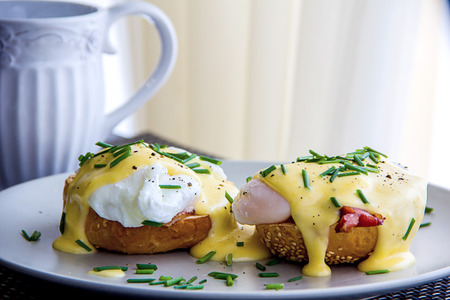 eggs: Eggs Benedict- toasted English muffins, ham, poached eggs, and delicious buttery hollandaise sauce