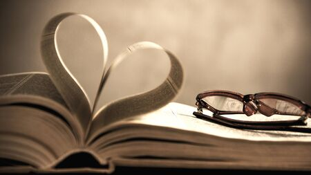 heart intelligence: symbol of the heart of the pages of an old book. Conceptual photo in vintage style. Stock Photo