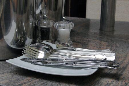 flatware: Dinner fork flatware, knives, salt, pepper on marble table