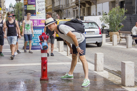 drinkable: Budapest, Hungary- July 19, 2016: Drinkable water column in the street of Budapest Editorial
