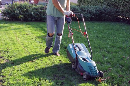 process of cutting the lawn with an electric lawn mower