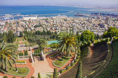 Bahai gardens and temple on the slopes of the Carmel Mountain and view of the Mediterranean Sea and bay of Haifa city, Israel
