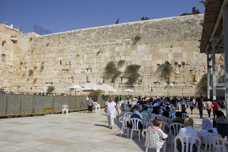 JERUSALEM, ISRAEL- 10202017: People praying the Western Wall, Wailing Wall or Kotel the Place of Weeping is an ancient limestone wall in the Old City of Jerusalem