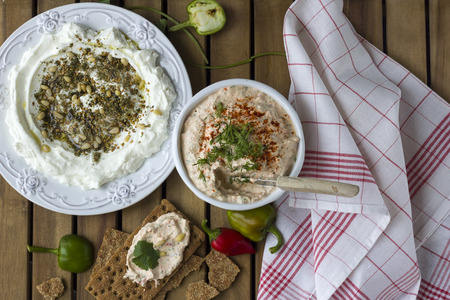 Middle Eastern dish - dense homemade labneh yoghurt with zatar in white dishes. Daylight. Stock Photo