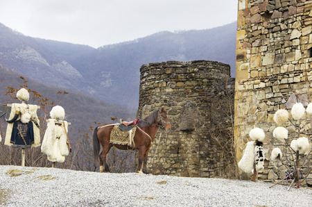 Magnificent mountain landscape with beautiful horse in the Caucasus Mountains and the national dress of the Highlanders