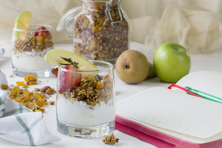 Healthy breakfast or snack with homemade yogurt with strawberries and granola in a glass. The concept of a healthy lifestyle, healthy food, diet. Stock Photo