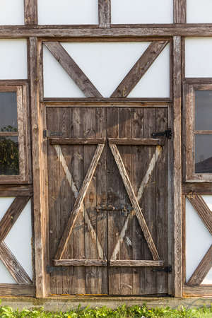 wooden door and windows decorated in the old style
