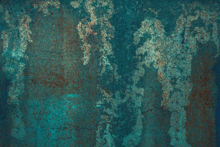 Luxurious abstract background of saturated shades of sea water, emerald. Corroded metal background. Oxidized metal, enamel, rusty metal texture, surface with rust streaks and scratches.
