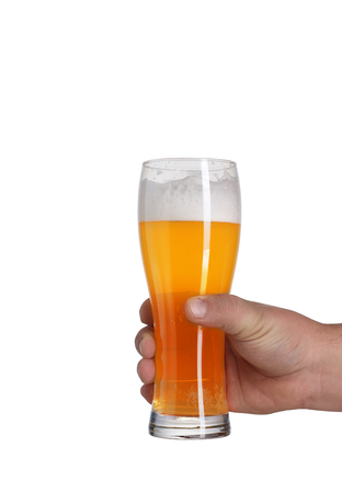 a pint of beer in a hand on a white background