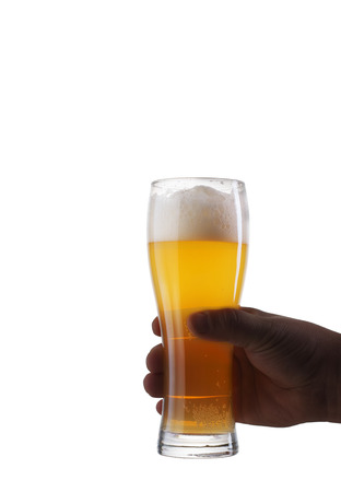 a pint of beer kept in a hand on a white background 写真素材