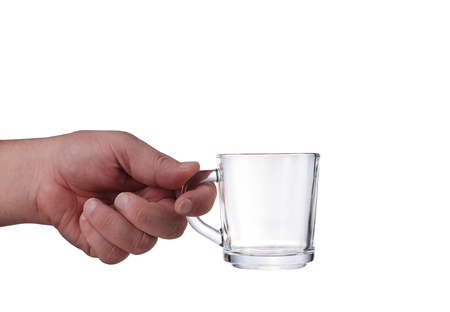 glass held in a hand on a white background